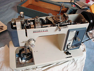 White sewing machine inner working