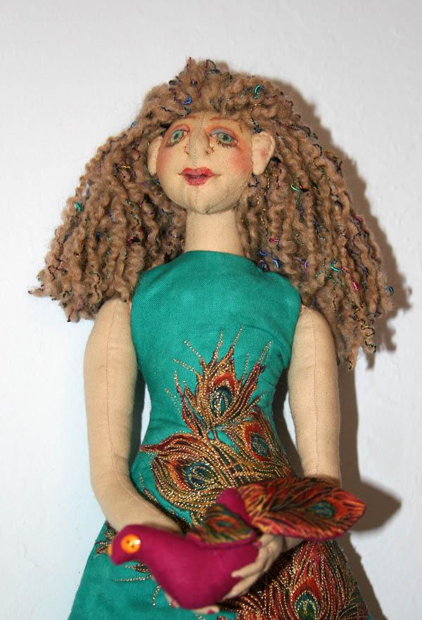 Doll holding bird detail