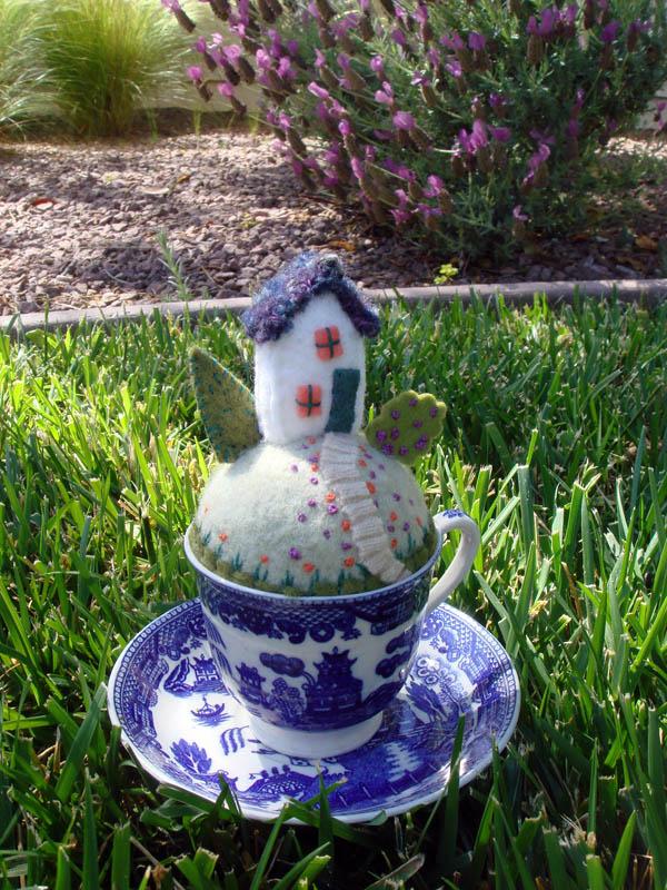 Tiny World Teacup Pincushion in yard