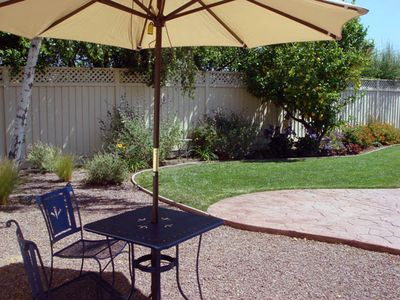 Metallic blue patio set with market umbrella