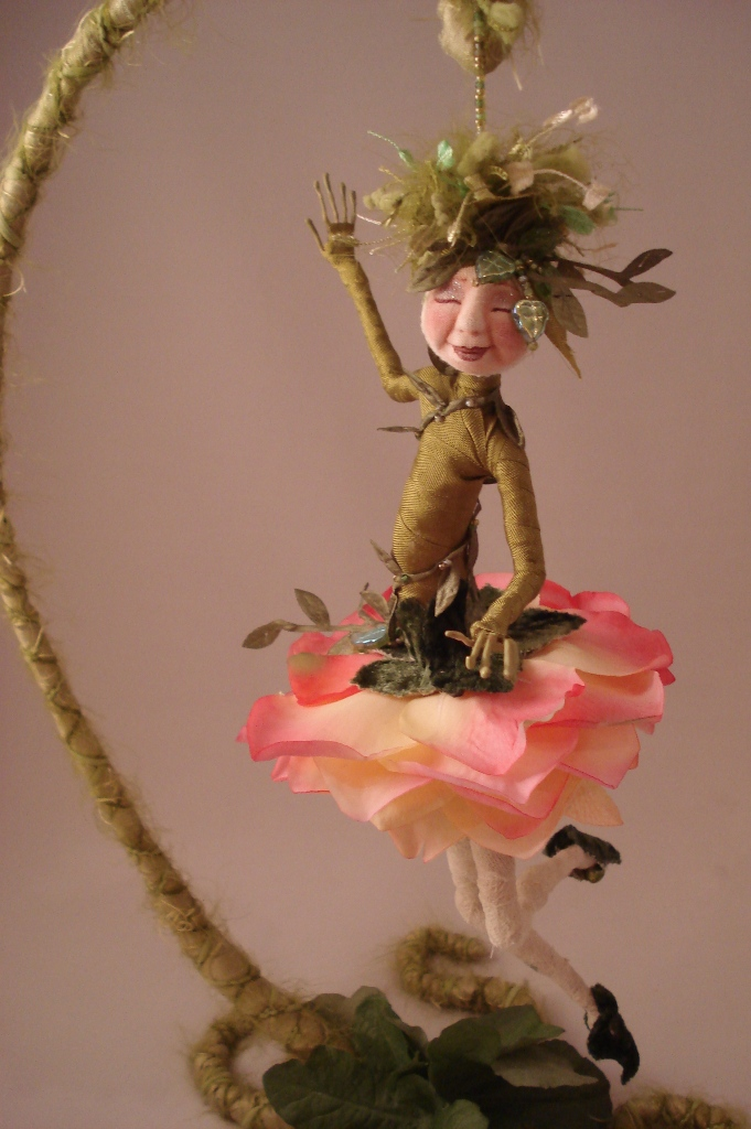 Cyndi Mahlstadt's Evie Mae flower doll and stand