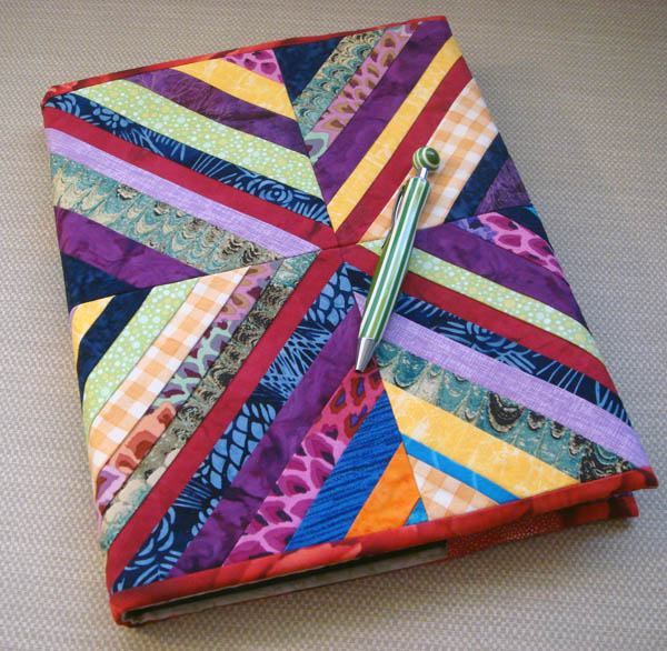 String pieced sketchbook cover