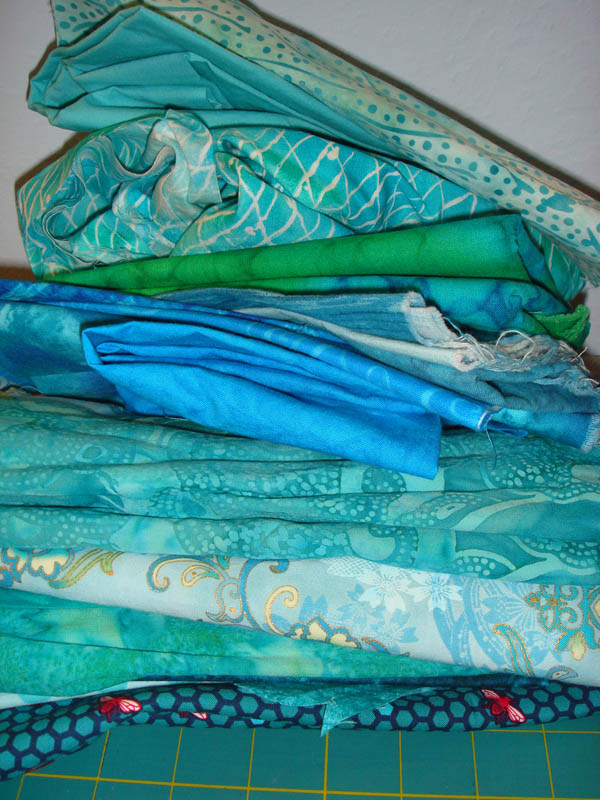 Turquoise fabrics for doll bed quilt