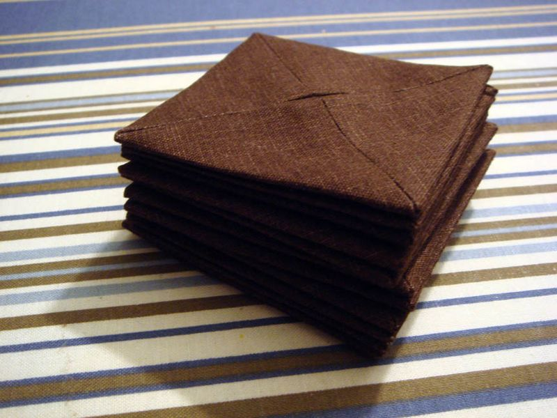 Stack of pressed brown blocks awaiting final folding