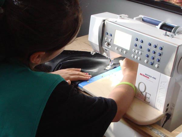 Miss L in costume sewing class