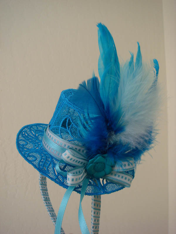 Miss Ls Turquoise Fascinator Hat on headband