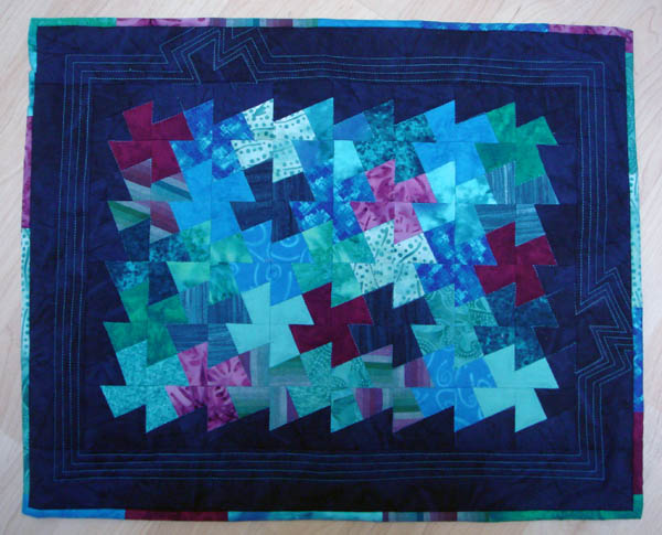 Pinwheel quilt for doll bed