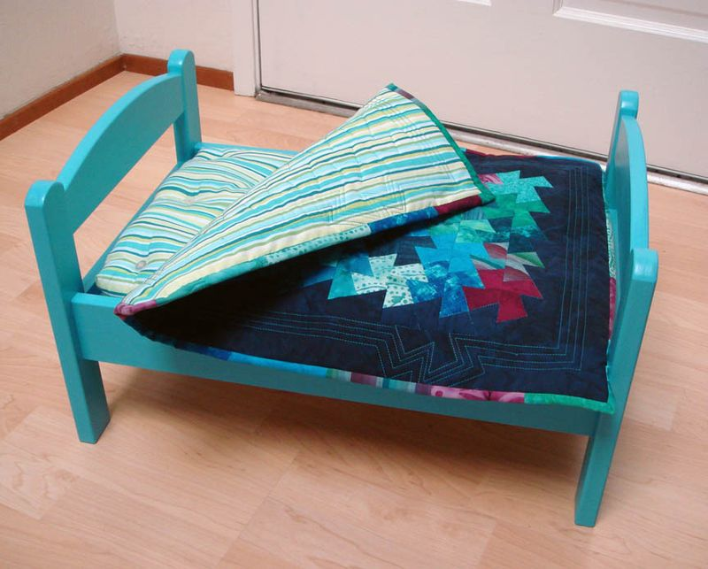 Miss Ls turquoise doll bed with mattress and quilt