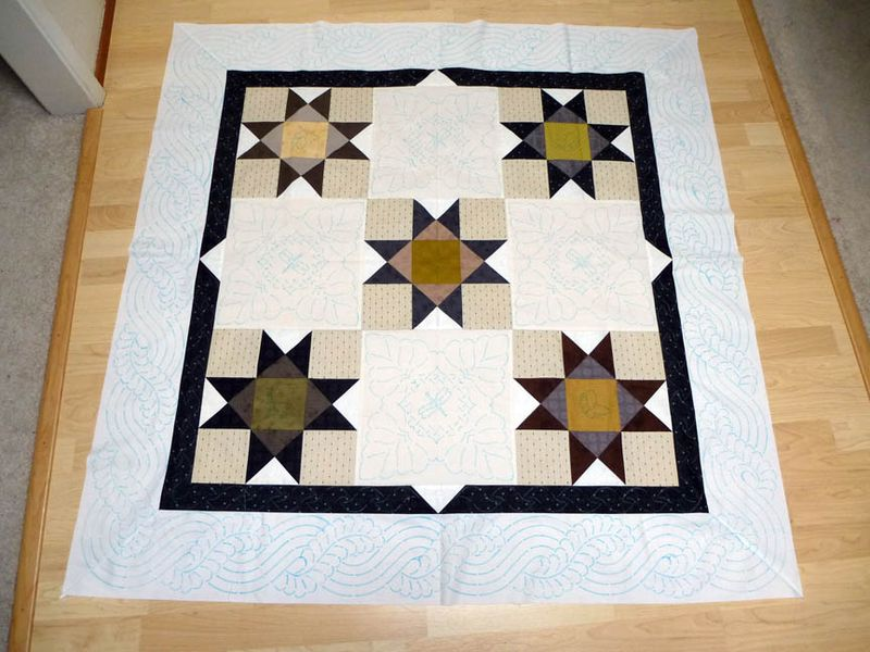 Ohio Star quilt top marked for quilting