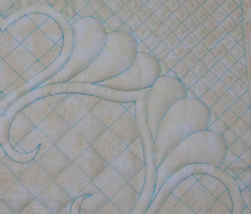 Trapunto wholecloth quilt