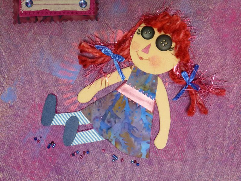 Daisy page rag doll detail