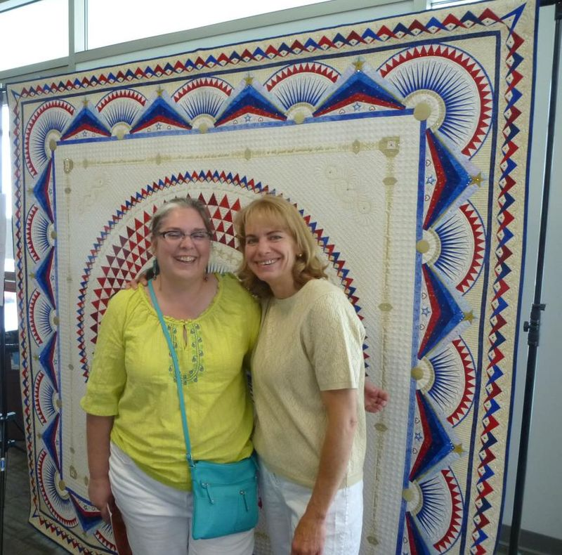 Tami and Sherry in front of Sherrys quilt America Let it Shine
