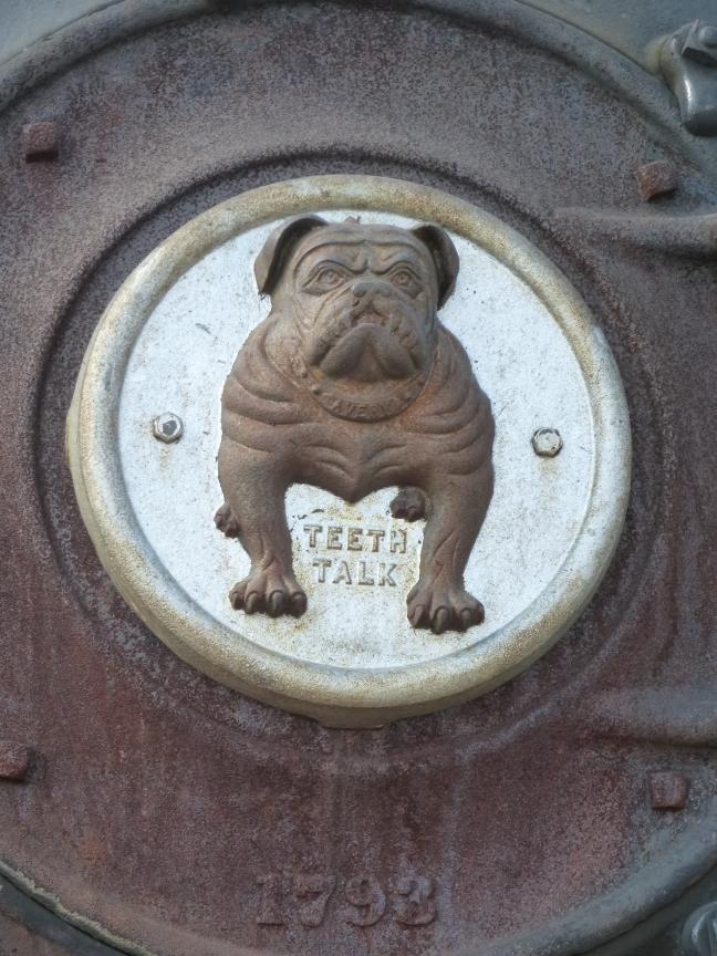 Teeth talk bulldog mascot of the 1909 Avery steam engine tractor