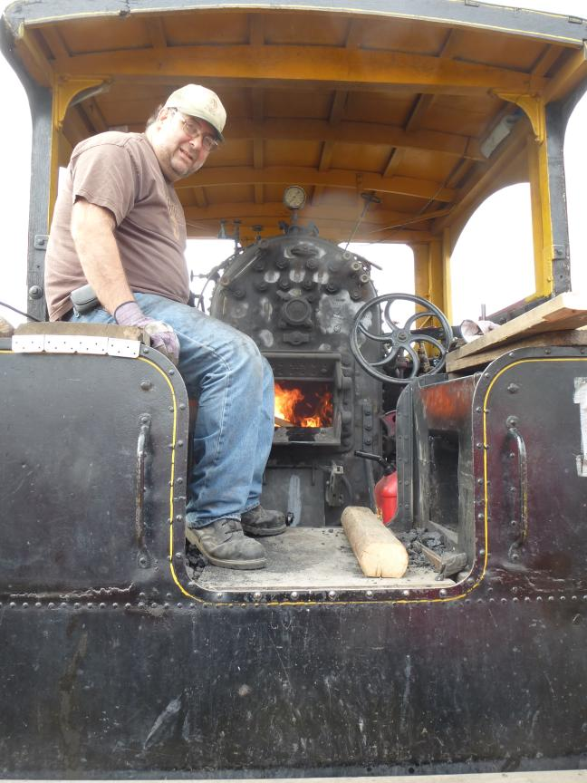 Mike stoking the fire of the 1909 Avery steam engine tractor