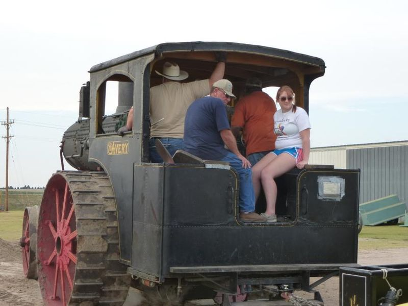 Levin family on the 1909 Avery steam engine tractor during tractor pull