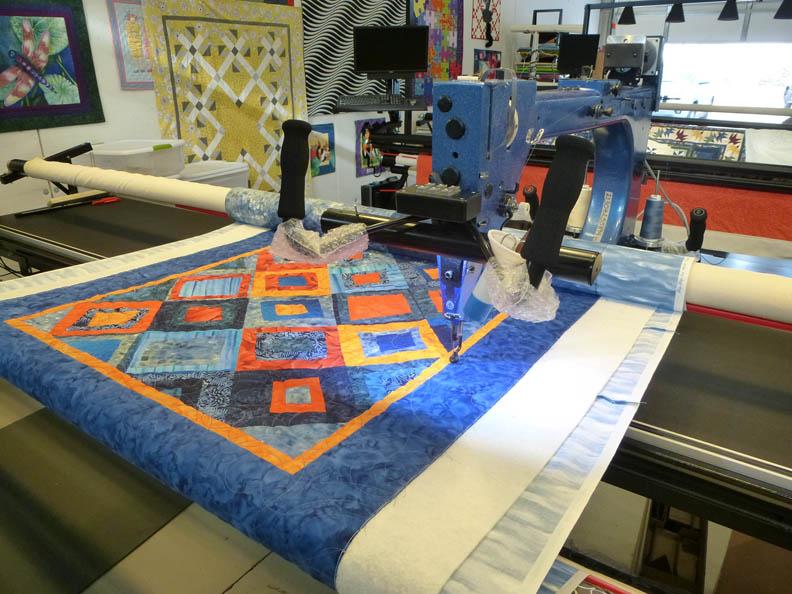 Blue Orange quilt on the longarm