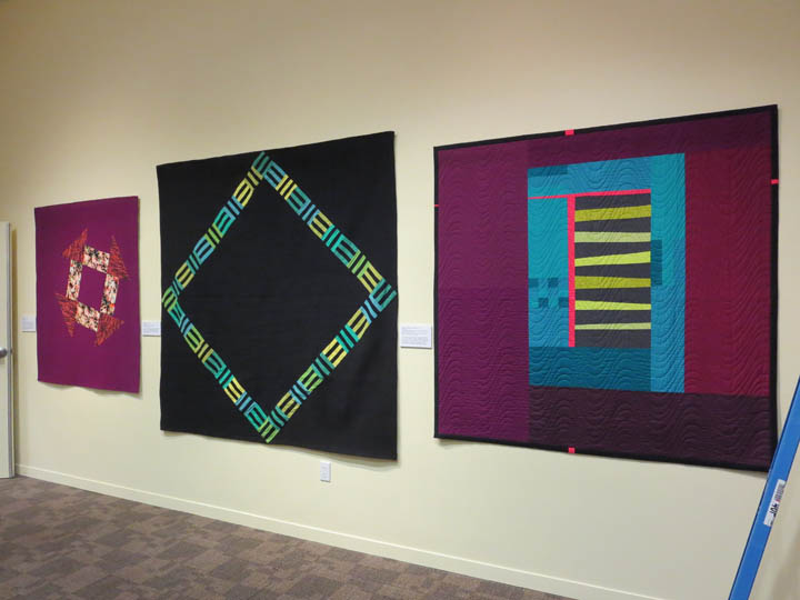 Hanging up quilts at museum