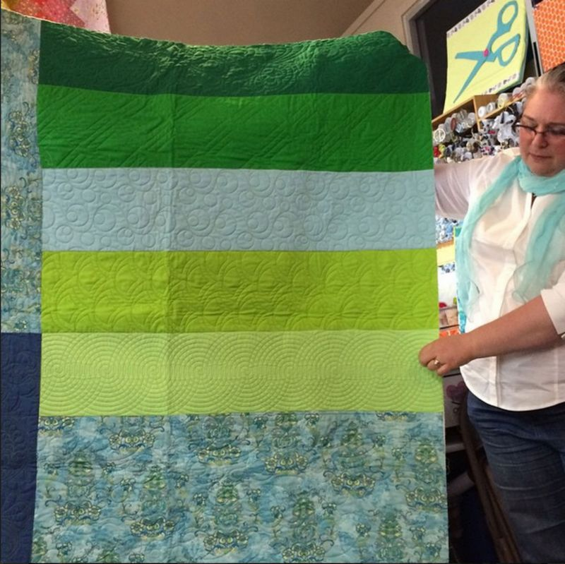 Tami Showing Quilting Sampler Quilt