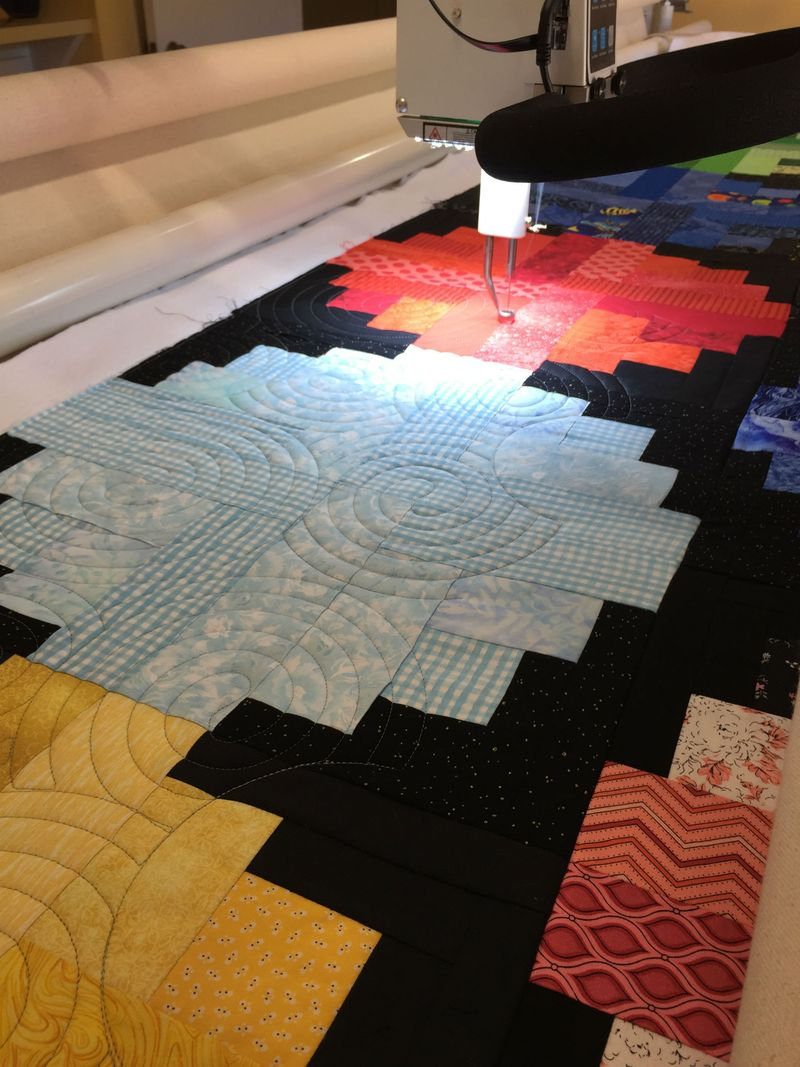 Quilting River Log Cabin Quilt on longarm