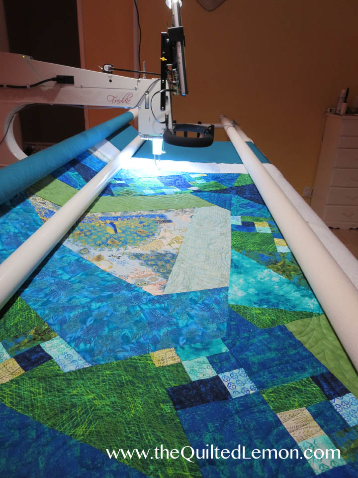 Peacock Plumes charity quilt on the frame