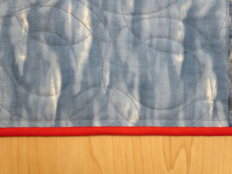 Faux piping binding back side of quilt