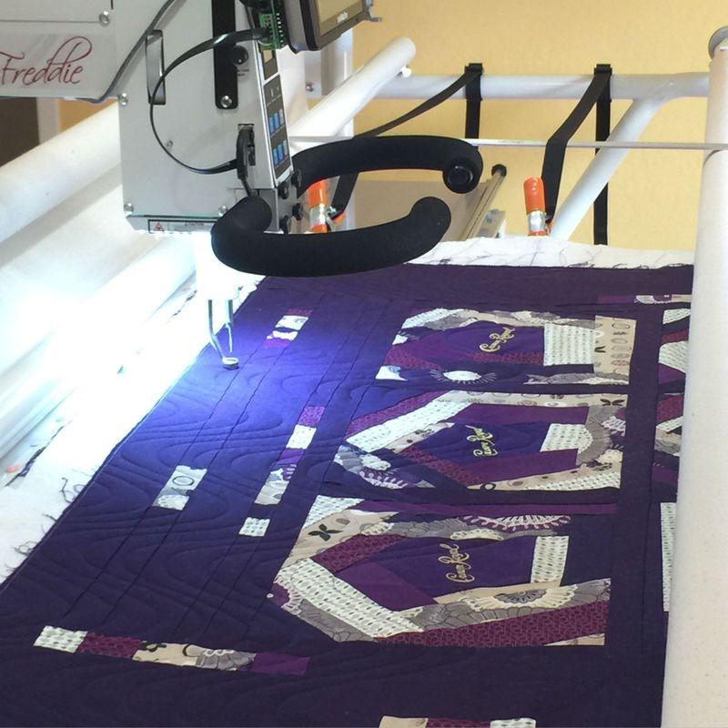 Crown Royal quilt on frame