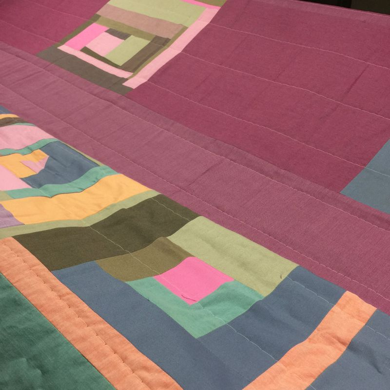 Tina log cabin quilt basted by longarm