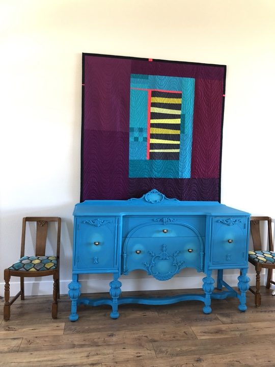 Chalk Painted buffet and quilt and chairs